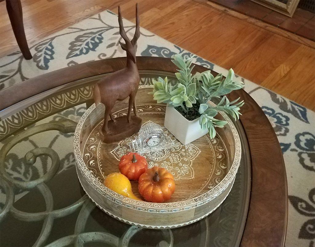 Fall tray filled with pumpkins, plant, clock
